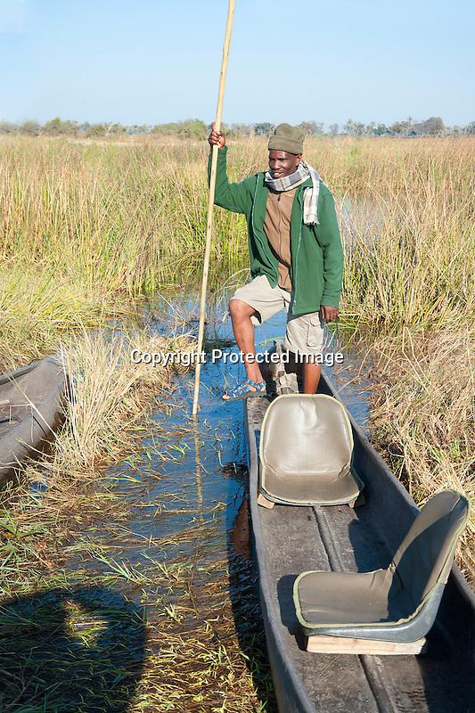 Mokoro Dugout Poler in Okavango Delta in Botswana in Africa