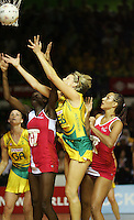 16.11.2007 Australian Catherine Cox and England's Sonia Mkoloma (L) and Geva Mentor in action during the Australia v England match at the New World Netball World Champs held at Trusts Stadium Auckland New Zealand. Mandatory Photo Credit ©Michael Bradley.