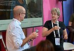 Sara Speicher of the World Council of Churches Ecumenical Advocacy Alliance talks about the WCC's Thursdays in Black campaign to Tim Martineau, acting executive director of UNAIDS, during a July 26 seminar in the Global Village of the 2018 International AIDS Conference in Amsterdam, Netherlands. The presentation was co-sponsored by the United Nations and the World Council of Churches Ecumenical Advocacy Alliance.