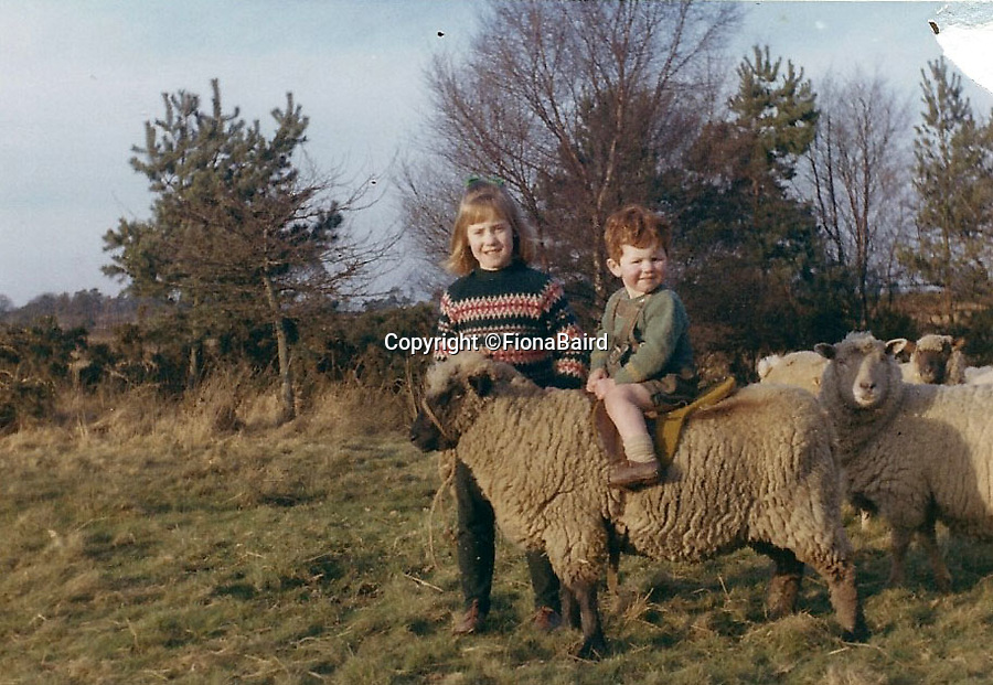BNPS.co.uk (01202 558833)Pic: FionaBaird/BNPSPerfect place to grow up - Fiona Baird with brother Neil and pet sheep called Big Ears in 1966.<br /> <br /> A picturesque cottage in the heart of Ashdown Forest - the inspirational setting for AA Milne's Winnie the Pooh - is on the market for just over £1million.<br /> <br /> Little Millbrook Farm is in a secluded setting down a long country lane and surrounded by the 6,500-acre forest in East Sussex, the perfect place for an idyllic childhood like the famous author's son Christopher had in the 1920s.<br /> <br /> The three-bedroom cottage is in need of updating and comes with planning permission to turn it into a five-bedroom family home.<br /> <br /> It has been in the same family for the last 56 years but has now gone on the market with Churchill Country and Equestrian with a guide price of £1,050,000.