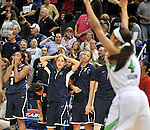 Notre Dame 4, Skylar Diggs raises her arms in victory as UConn players react after the winning basket is sunk at the buzzer, March 12, 2013, during the Big East Women's Championship game, at the XL Center in Hartford. (Jim Michaud / Journal Inquirer)