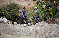 Pictured: A forensic archaeologist and a worker work at the second site in Kos, Greece. Tuesday 11 October 2016<br />