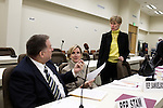 March 17, 2009. Raleigh, NC.. Images from one day in the life of Deborah K. Ross, Representative for North Carolina House District 38.. 11:44 AM. Ross speaks to Rep. Paul Stam, (R) of  Wake Co.,  and Rep. Ruth Samuelson, (R) of Mecklenburg Co.,  after a meeting of the education committee.