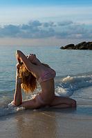 Pigeon pose - beach yoga in Thailand, Koh Lipe island