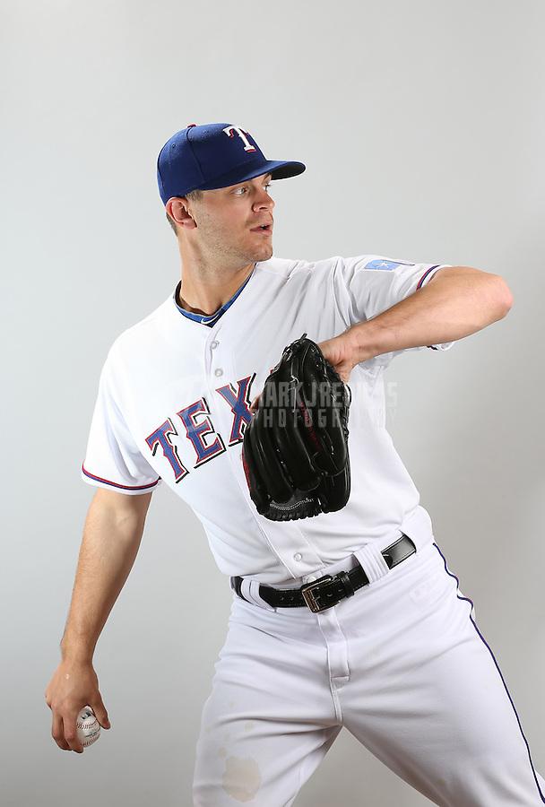 Feb. 20, 2013; Surprise, AZ, USA: Texas Rangers pitcher Justin Grimm poses for a portrait during photo day at Surprise Stadium. Mandatory Credit: Mark J. Rebilas-