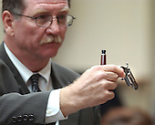 Prince William County (Virginia) prosecutor Richard C. Conway holds a gun that was found in Montgomery, Alabama, apartment building during testimony at the trial of sniper suspect John Allen Muhammad, at the Virginia Beach Circuit Court  in Virginia Beach, Virginia on October 24, 2003. <br /> Credit: Davis Turner - Pool via CNP