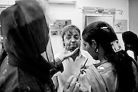 Urooj Akbar,29 (C) has make-up applied by Depilex-Smileagain foundation owner, Massarat Misbah at a Depilex salon where she is working as a beautician in Lahore, Pakistan...Urooj had acid thrown at  her face 5 years ago by her husband after giving birth to a daughter...Stigmatised by her family,she now lives at a hostel. Her daughterlives with her husband and in-laws.  Urooj is not able to see her daughter anymore.  daughterlives with her husband and in-laws.  Urooj is not able to see her daughter anymore.
