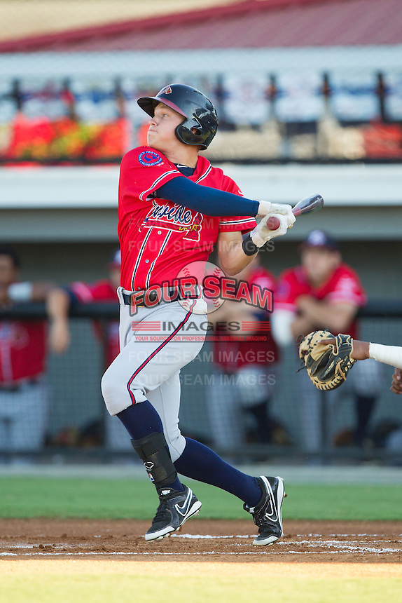 Jordan Edgerton (18) of the Danville Braves follows through on his swing against the Burlington Royals at Burlington Athletic Park on July 5, 2014 in Burlington, North Carolina.  The Royals defeated the Braves 5-4.  (Brian Westerholt/Four Seam Images)