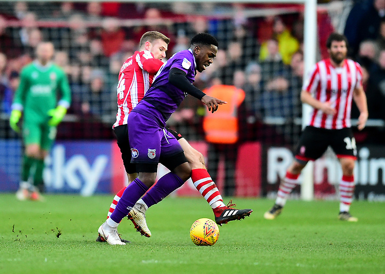 Lincoln City's Michael O'Connor battles with  Grimsby Town's Mitch Rose<br /> <br /> Photographer Andrew Vaughan/CameraSport<br /> <br /> The EFL Sky Bet League Two - Lincoln City v Grimsby Town - Saturday 19 January 2019 - Sincil Bank - Lincoln<br /> <br /> World Copyright &copy; 2019 CameraSport. All rights reserved. 43 Linden Ave. Countesthorpe. Leicester. England. LE8 5PG - Tel: +44 (0) 116 277 4147 - admin@camerasport.com - www.camerasport.com
