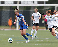 Boston Breakers midfielder Joanna Lohman (11) controls the ball as Portland Thorns FC midfielder Meleana Shim (6) reacts. In a National Women's Soccer League (NWSL) match, Portland Thorns FC (white/black) defeated Boston Breakers (blue), 2-1, at Dilboy Stadium on July 21, 2013.