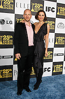 US actor Peter Sarsgaard and wife US actress Maggie Gyllenhaal arrive at the 25th Independent Spirit Awards held at the Nokia Theater in Los Angeles on March 5, 2010. The Independent Spirit Awards is a celebration honoring films made by filmmakers who embody independence and originality..Photo by Nina Prommer/Milestone Photo