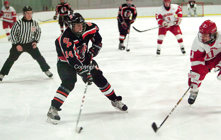 MIDDLETOWN, CT, 05 JANUARY 2011-010511JS07--Watertown-Pomperaug's Eric Fischthal (14) takes a shot on goal in front of Cheshire's Jake Nesdale (11) during their game Wednesday at Wesleyan University in Middletown. <br /> Jim Shannon Republican-American