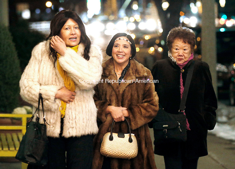 """Torrington, CT- 02 January 2016-010216CM08-  From left, Tess Drezek of Farmington, Gina Gatmaitan of Simsbury and Lily Holthoff of West Hartford arrive for a preview of the premier of the PBS drama series """"Downton Abbey"""" at the Warner Theatre in Torrington on Saturday.      Christopher Massa Republican-American"""