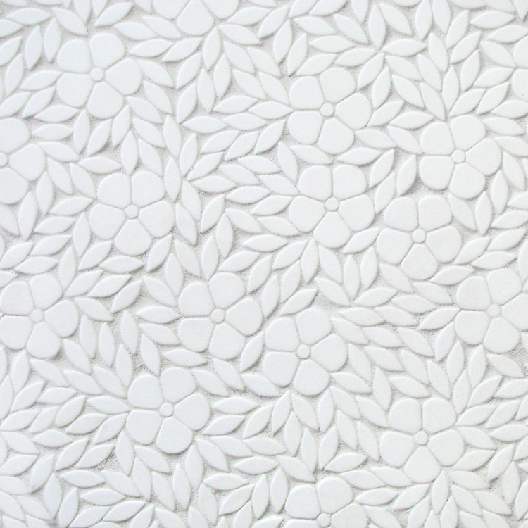 Jacqueline, a waterjet stone mosaic shown in tumbled Thassos, is part of the Silk Road® collection by New Ravenna.
