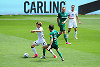 Conor Gallagher of Swansea City under pressure from Kieran Lee of Sheffield Wednesday during the Sky Bet Championship match between Swansea City and Sheffield Wednesday at the Liberty Stadium in Swansea, Wales, UK. Sunday 05 July 2020