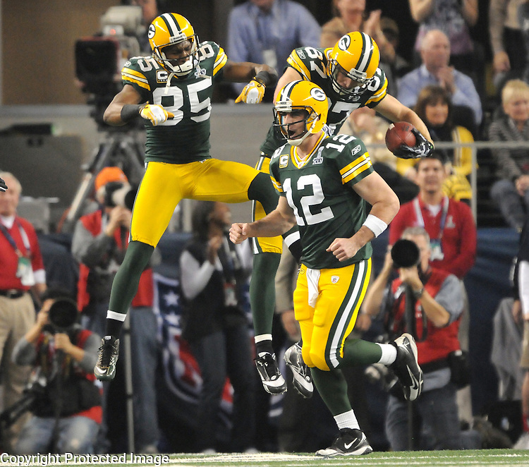 Green Bay Packers quarterback Aaron Rodgers cheers as receivers Greg Jennings, left, and Jordy Nelson, right celebrate Nelson's touchdown catch in the first quarter against the Pittsburgh Steelers in Super Bowl XLV at Cowboys Stadium in Arlington, Texas on Feb. 6, 2011.