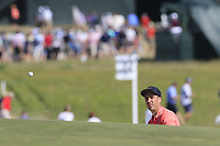 Ross Fisher (ENG) chips onto the 17th green during Thursday's Round 1 of the 118th U.S. Open Championship 2018, held at Shinnecock Hills Club, Southampton, New Jersey, USA. 14th June 2018.<br /> Picture: Eoin Clarke | Golffile<br /> <br /> <br /> All photos usage must carry mandatory copyright credit (&copy; Golffile | Eoin Clarke)