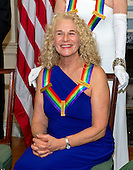 Singer-songwriter Carole King, one of the five recipients of the 38th Annual Kennedy Center Honors, poses as part of a group photo following a dinner hosted by United States Secretary of State John F. Kerry in their honor at the U.S. Department of State in Washington, D.C. on Saturday, December 5, 2015.  The 2015 honorees are: singer-songwriter Carole King, filmmaker George Lucas, actress and singer Rita Moreno, conductor Seiji Ozawa, and actress and Broadway star Cicely Tyson.<br /> Credit: Ron Sachs / Pool via CNP
