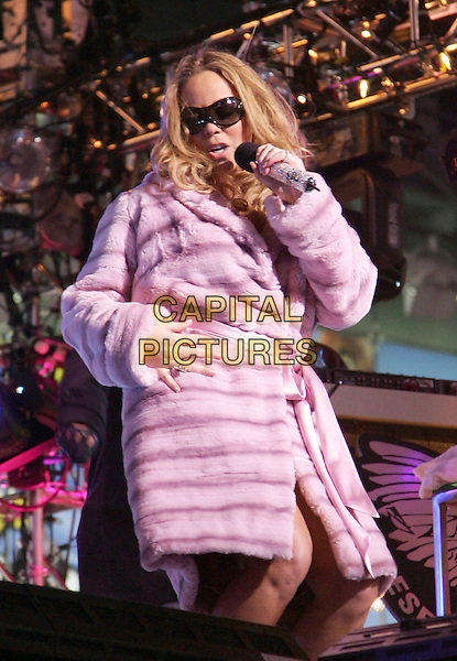 MARIAH CAREY.New Year's Eve 2006 at Times Square, NYC, New York, NY.January 1st, 2006.Photo: Jackson Lee/Admedia/Capital Pictures.Ref: JL/ADM.half length stage concert live music performance singing pink fur sunglasses shades.www.capitalpictures.com.sales@capitalpictures.com.© Capital Pictures.