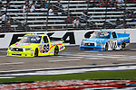 Camping World Truck Series driver Matt Crafton (88) and German Quiroga (77) in action during the NCWTS Winstar World Casino 400 race at Texas Motor Speedway in Fort Worth,Texas.