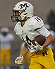 Massapequa No. 14 Chris Bacotti races upfield during a Nassau County Conference I varsity football game against host Freeport High School on Friday, September 25, 2015<br /> <br /> James Escher