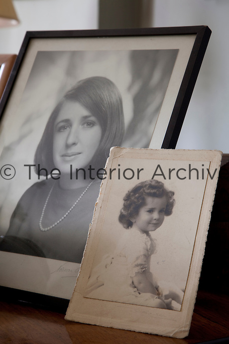Photographs of Lesley Fennell on top of the piano in the drawing room