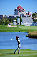 Justin Thomas (USA) hits his approach shot on 4 during round 1 foursomes of the 2017 President's Cup, Liberty National Golf Club, Jersey City, New Jersey, USA. 9/28/2017.<br /> Picture: Golffile   Ken Murray<br /> ll photo usage must carry mandatory copyright credit (&copy; Golffile   Ken Murray)