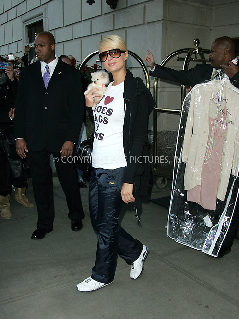 """WWW.ACEPIXS.COM . . . . . ....November 13 2007, New York City....Paris Hilton was spotted leaving her Manhattan hotel with her dog and a tee shirt that read """"I love shoes, bags and toys"""".....Please byline: DAVID MURPHY - ACEPIXS.COM.. . . . . . ..Ace Pictures, Inc:  ..(646) 769 0430..e-mail: info@acepixs.com..web: http://www.acepixs.com"""
