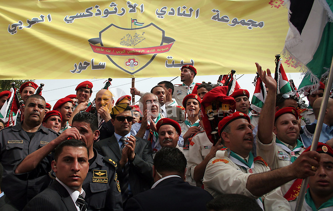 Palestinian Prime Minister Salam Fayyad takes part the celebrations during his visit to the town of Beit Sahour near the West Bank city of Bethlehem on 03 April 2010. Christians around the world are marking the Holy Week, commemorating the crucifixion of Jesus Christ, leading up to his resurrection on Easter. Photo by Najeh Hashlamoun