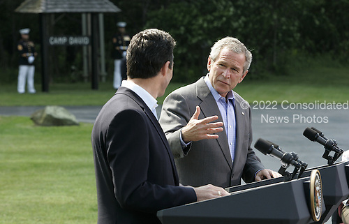 Camp David, MD - June 9, 2006 -- United States President  George W. Bush, with Prime Minister Anders Fogh Rasmussen of Denmark, responds to a question from the news media during a joint press conference at Camp David, Maryland Friday 09 June 2006. President Bush plans to mix discussions on international issues with outdoor exercise as he hosts fellow fitness buff, the prime minister of Denmark, at Camp David..Credit: Shawn Thew - Pool via CNP