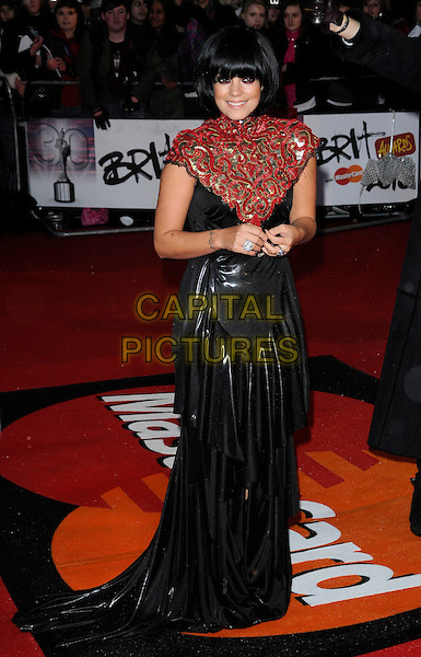LILY ALLEN.Arrivals the Brit Awards 2010 held at Earls Court, London, England..February 16th 2010 .Brits full length red gold sequined sequins pattern high neck dress black shiny maxi tiered layered layers  buckle silver .CAP/CAN.©Can Nguyen/Capital Pictures.