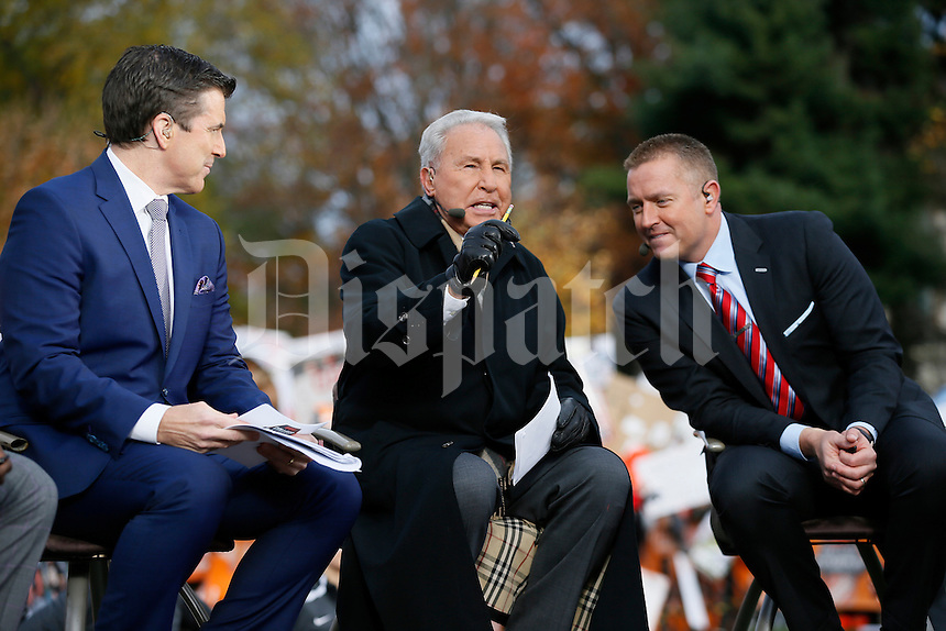 Rece Davis, left, and Kirk Herbstreit, right, listen as Lee Corso talks during ESPN's College GameDay broadcast from the campus of Ohio State prior to the NCAA football game against the Michigan State Spartans in Columbus on Nov. 21, 2015. (Adam Cairns / The Columbus Dispatch)