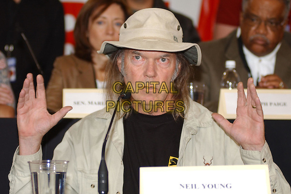 NEIL YOUNG.during Farm Aid 2004 held at White River Amphitheatre, Seattle, WA, USA, September 18th 2004..half length hat hands gesture.Ref: ADM.www.capitalpictures.com.sales@capitalpictures.com.©GS/AdMedia/Capital Pictures .