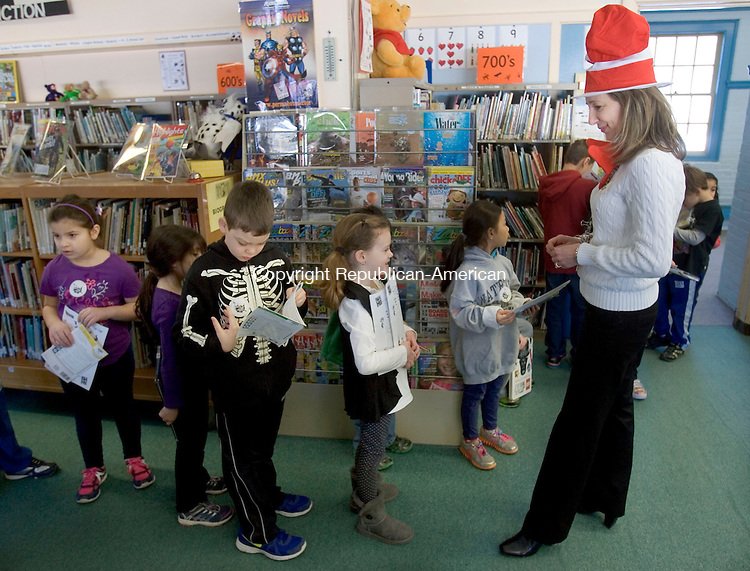 WOODBURY CT. 28 February 2014-022814SV06-Jodie D&rsquo;Alexander, Liberian, talks with students dressed in a Dr. Seuss hat at Mitchell Elementary School in Middlebury Friday. Local people were reading Dr. Seuss books to the students.<br /> Steven Valenti Republican-American