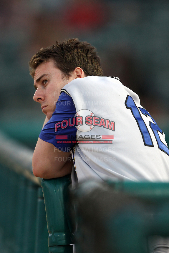 Gabe Suarez #12 of the Rancho Cucamonga Quakes watches a game against the Lancaster JetHawks at Clear Channel Stadium on August 22, 2012 in Lancaster, California. Rancho Cucamonga defeated Lancaster 8-7. (Larry Goren/Four Seam Images)
