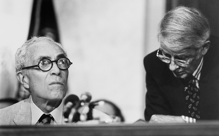 Sen. Claiborne Pell, D-R.I., glances at clock for 10.30 am mark-up during a Senate Rules JCOC with Orlando Potter, Legislative Director, on June 20, 1994. (Photo by Laura Patterson/CQ Roll Call)