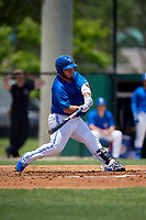 Dunedin Blue Jays Alejandro Kirk (26) hits a double during a Florida State League game against the Jupiter Hammerheads on May 16, 2019 at Jack Russell Memorial Stadium in Clearwater, Florida.  Dunedin defeated Jupiter 1-0.  (Mike Janes/Four Seam Images)