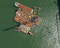 aerial photograph of construction barges crane and tug boats with materials for San Francisco Oakland Bay Bridge replacement span