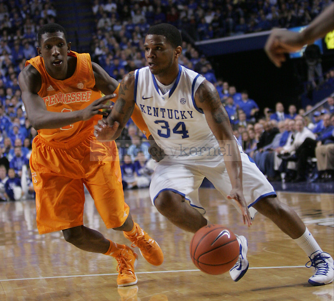 Senior Guard Julius Mays (32) cuts inside toward the basket against Tennessee's Sophomore Guard Josh Richardson (1) during the University of Kentucky vs Tennessee Men's Basketball game in Lexington, Ky., on, January 15, 2013. Photo by Jared Glover | Staff