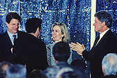 First lady Hillary Rodham Clinton, right center, greets performer Mandy Patinkin, left center, following a performance on the South Lawn of the White House in Washington, D.C. during a reception the evening prior to the dedication of the U.S. Holocaust Museum on April 21, 1993.  Looking on are United States President Bill Clinton, right, and U.S. Vice President Al Gore, left.<br /> Credit: Ron Sachs / CNP