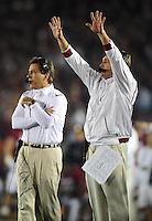 Jan 7, 2010; Pasadena, CA, USA; Alabama Crimson Tide head coach Nick Saban (left) during the first quarter of the 2010 BCS national championship game against the Texas Longhorns at the Rose Bowl.  Mandatory Credit: Mark J. Rebilas-