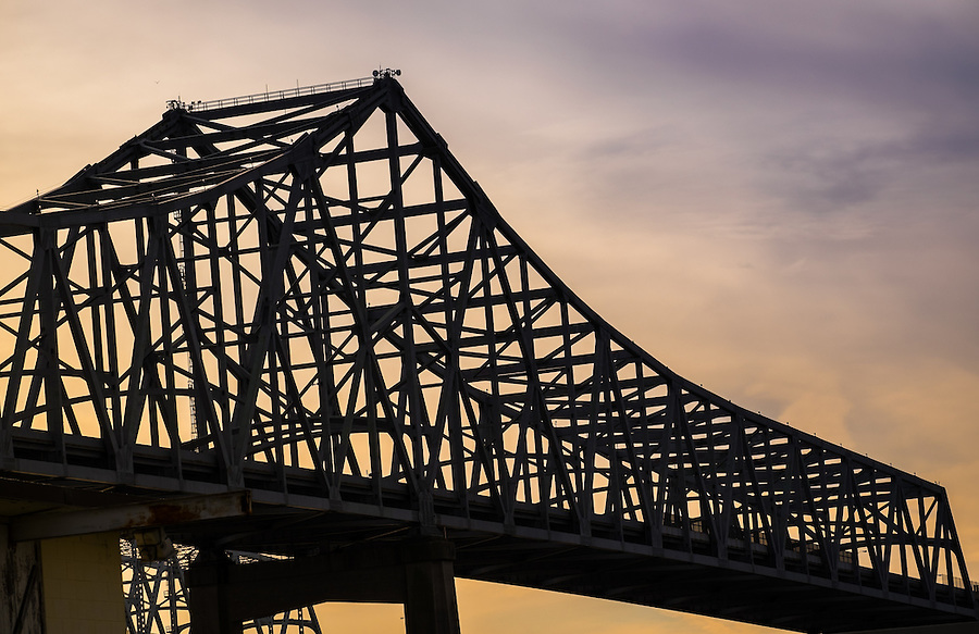 NEW ORLEANS - CIRCA FEBRUARY 2014: Structure of the Crescent City Connection over the Mississippi River in New Orleans at sunset.