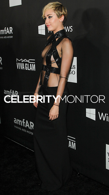 HOLLYWOOD, LOS ANGELES, CA, USA - OCTOBER 29: Miley Cyrus arrives at the 2014 amfAR LA Inspiration Gala at Milk Studios on October 29, 2014 in Hollywood, Los Angeles, California, United States. (Photo by Celebrity Monitor)