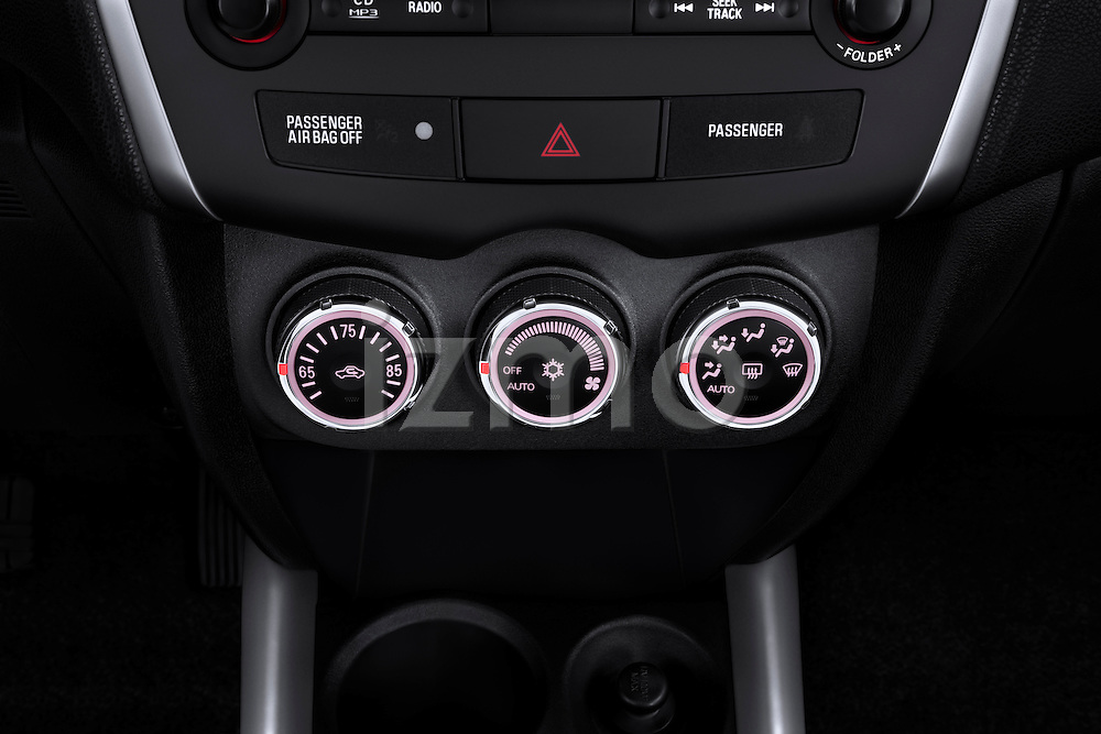 Closeup view of climate controls on a 2012 Mitsubishi Outlander Sport