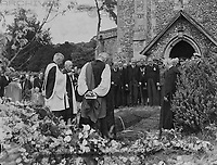 Viscount Bennett, former Prime Minister of Canada, known as the Empire builder, was buried at St Michaels, picturesque 14th century parish church of Mickelham, Surrey, yesterday, a few yards from the drive of the house where he lived in his retirement. The service was conducted by the Bishop of Guildford - Dr J. Macmillan. <br /> Picture shows: the mourners which included senior officers of the services and representatives of the Empire, pictured at the graveside of Viscount Burnett during the burial ceremony Mickelham.<br /> 1 July 1947