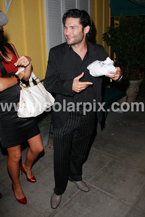 **ALL ROUND PICTURES FROM SOLARPIX.COM**.**WORLDWIDE SYNDICATION RIGHTS**.**NO PUBLICATION IN AUSTRALIA, DENMARK, GERMANY, NEW ZEALAND, OR USA**.Corey Feldman and wife Susie seen enjoying conversation with the surrounding paparazzi after a late dinner at Dan Tana's Restaurant in West Hollywood, California, USA. 4th September 2008..This pic: Corey Feldman..JOB REF: 7221 LAP(JS)       DATE: 04_09_2008.**MUST CREDIT SOLARPIX.COM OR DOUBLE FEE WILL BE CHARGED* *UNDER NO CIRCUMSTANCES IS THIS IMAGE TO BE REPRODUCED FOR ANY ONLINE EDITION WITHOUT PRIOR PERMISSION*