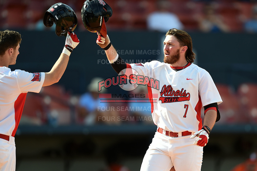 Illinois State Redbirds Mason Snyder (7) greeted by teammates after hitting a home run during a game against the Bowling Green Falcons on March 11, 2015 at Chain of Lakes Stadium in Winter Haven, Florida.  Illinois State defeated Bowling Green 8-7.  (Mike Janes/Four Seam Images)