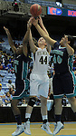 Bishop McGuinness'  Cameron Nieters (44) grabs a rebound between Southside's Breonna Blango, left, and Kyajia Mourning, (40) during the Villains' 60-44 win, a 7th-consecutive state title and a new state record, at the Dean Smith Center in Chapel Hill, NC, on Saturday, March 10, 2012.  Photo by Ted Richardson