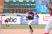 Erie Seawolves infielder Shawn Roof #28 runs to third on a base hit during a game against the Reading Phillies at Jerry Uht Park on May 29, 2011 in Erie, Pennsylvania.  Erie defeated Reading 6-5 in ten innings.  Photo By Mike Janes/Four Seam Images