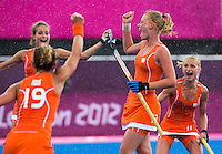 29 JUL 2012 - LONDON, GBR - Caia van Maasakker (NED) (second from right) of Netherlands celebrates scoring during the women's London 2012 Olympic Games Preliminary round hockey match against Belgium at the Riverbank Arena in the Olympic Park in Stratford, London, Great Britain (PHOTO (C) 2012 NIGEL FARROW)